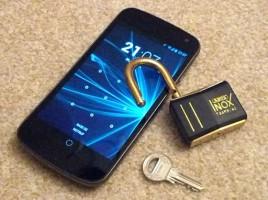 Handy mit ABUS Schloss und Schlüssel